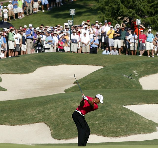 Tiger Woods hits up to the 14th green during the first round of the PGA Championship golf tournament Thursday, Aug. 11, 2011, at the Atlanta Athletic Club in Johns Creek, Ga.