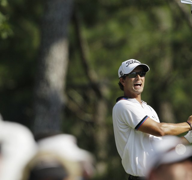 Adam Scott, of Australia, reacts to his tee shot on the 17th hole during the second round of the PGA Championship golf tournament Friday, Aug. 12, 2011, at the Atlanta Athletic Club in Johns Creek, Ga.