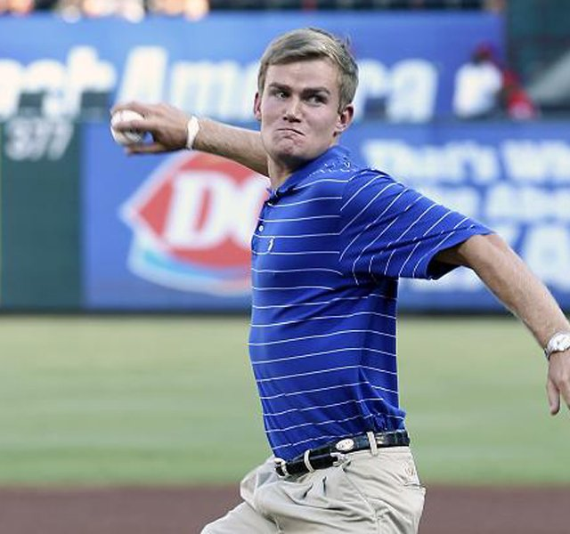 LSU's John Peterson, the 2011 NCAA individual champion, threw out the first pitch at a Texas Rangers-Seattle Mariners game.