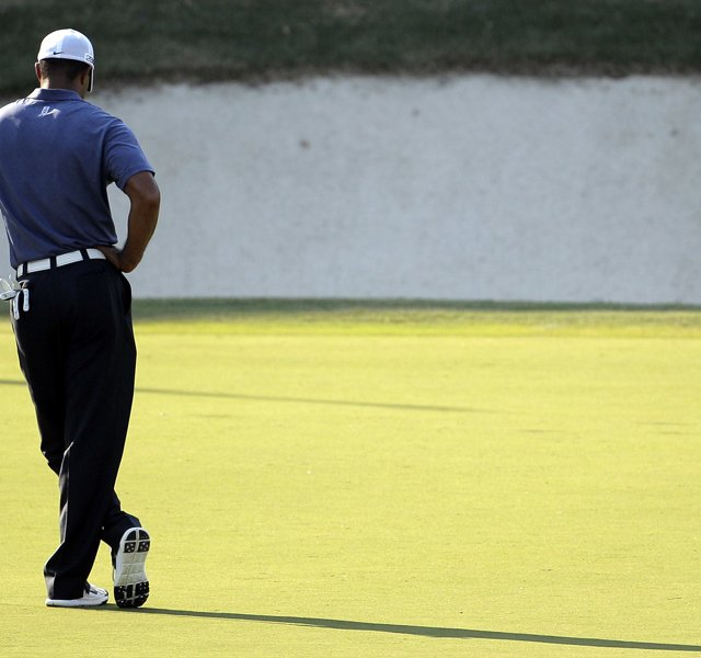 Tiger Woods waits to putt on the 17th hole during the second round of the PGA Championship golf tournament Friday, Aug. 12, 2011, at the Atlanta Athletic Club in Johns Creek, Ga.
