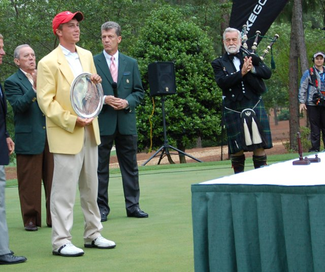 Nicholas Reach, in his gold jacket, after winning the Junior Invitational at Sage Valley.