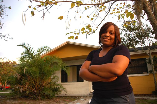 Vickie Johnson stands in front of her Altamonte Springs home that she's trying to keep from foreclosure.