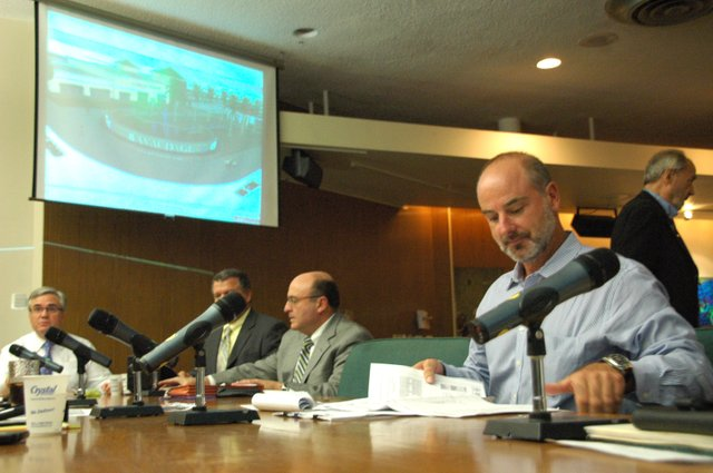 Developer Dan Bellows, right, discussed new plans for the Ravaudage project at the Winter Park City Commission meeting Aug. 22.