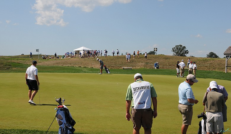 Players warm up for a playoff at the U.S. Amateur.