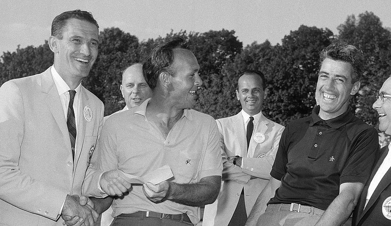 Paul Harney, far right, after losing a playoff to Arnold Palmer, middle, at the Thunderbird tournament at Westchester Country Club in Harrison, N.Y.