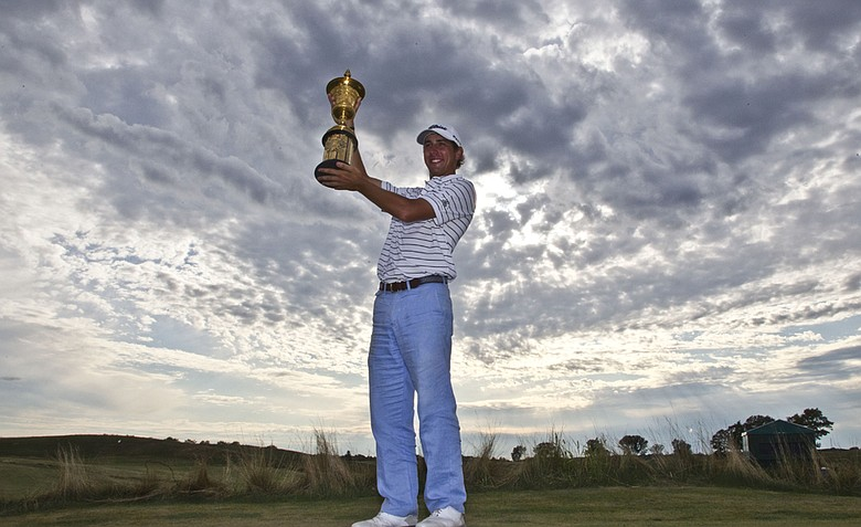 Kelly Kraft, of Denton, Texas, poses with his championship trophy after the final round at the U.S. Amateur golf tournament Sunday, Aug. 28, 2011, at Erin Hills in Erin, Wis. Kraft defeated Patrick Cantlay, of Los Alamitos, Calif., 2-up to win the tournament.