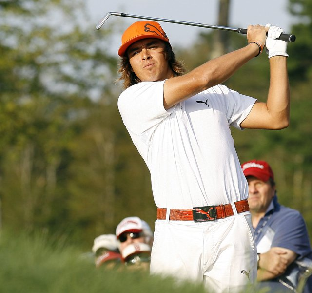 Rickie Fowler hits his second shot on the second hole during the second round of the Deutsche Bank Championship golf tournament at TPC Boston, Saturday, Sept. 3, 2011, in Norton, Mass.