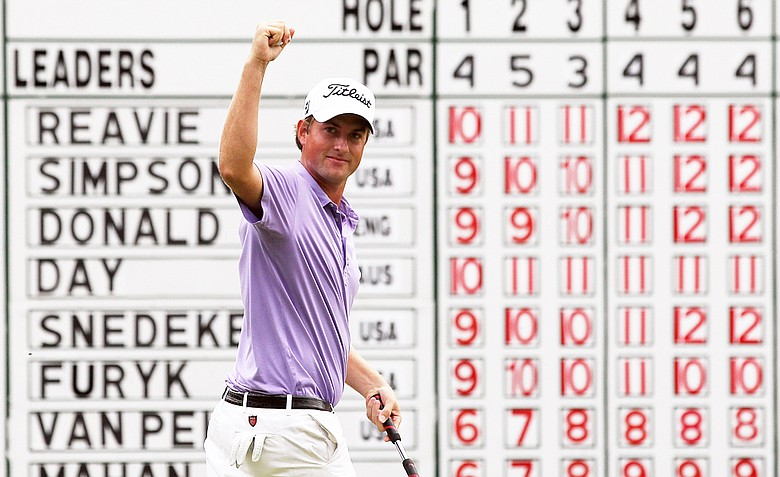 Webb Simpson reacts after he made a putt for birdie on the 18th hole during the final round of the Deutsche Bank Championship at TPC Boston on September 5, 2011 in Norton, Massachusetts. Simpson would make another birdie at 18 in the first hole of a playoff, followed by a dramatic birdie on the second playoff hole to win the title.