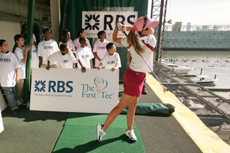 Paula Creamer hits balls during a First Tee event at Chelsea Piers.