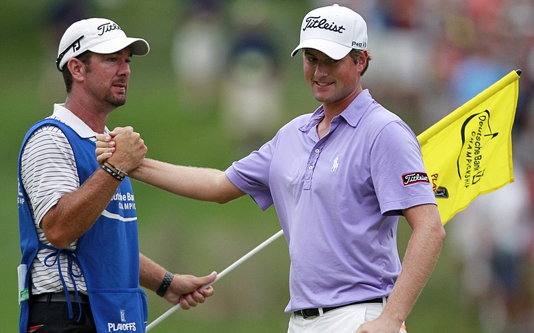 Caddie Paul Tesori (left) congratulates Webb Simpson after winning the Deutsche Bank Championship.