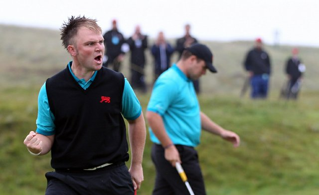 Andy Sullivan of Great Britain and Ireland celebrates a birdie putt on the fourth green during the day one morning foursomes matches of the 2011 Walker Cup held on the Balgownie Links at Royal Aberdeen Golf Club on September 10, 2011 in Aberdeen, Scotland.