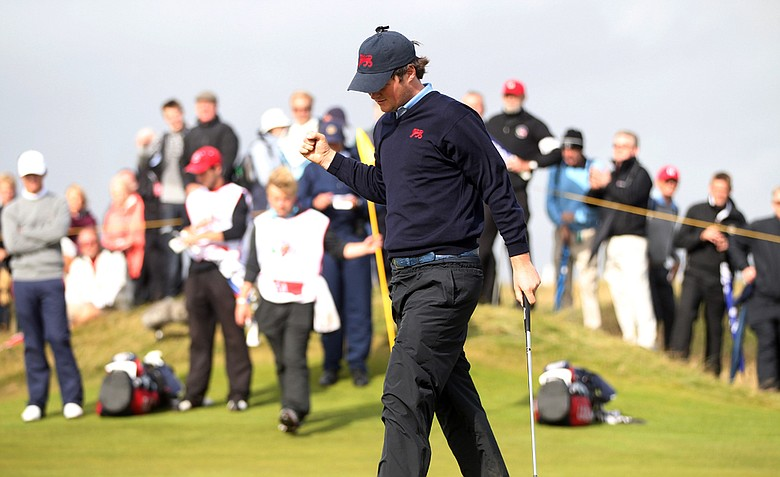 Alan Dunbar of Great Britain and Ireland celebrates after sinking a putt on No. 17 during the Day 2 morning foursomes matches of the 2011 Walker Cup held on the Balgownie Links at Royal Aberdeen Golf Club on September 11, 2011 in Aberdeen, Scotland.