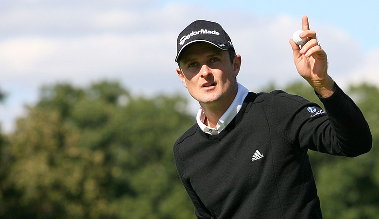 Justin Rose reacts after a birdie putt on the ninth hole during the first round of the BMW Championship at Cog Hill Golf & Country Club.