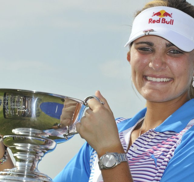 Lexi Thompson holds high her trophy after winning the Navistar LPGA Classic on the Robert Trent Jones Golf Trail at Capitol Hill in Prattville, Ala., on Sunday Sept. 18, 2011.
