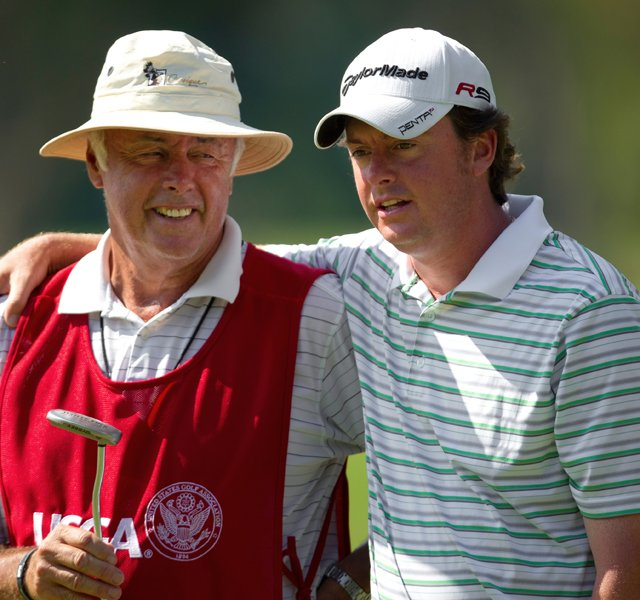 Nathan Smith (right) and his father/caddie Larry during the U.S. Mid-Amateur Championship.