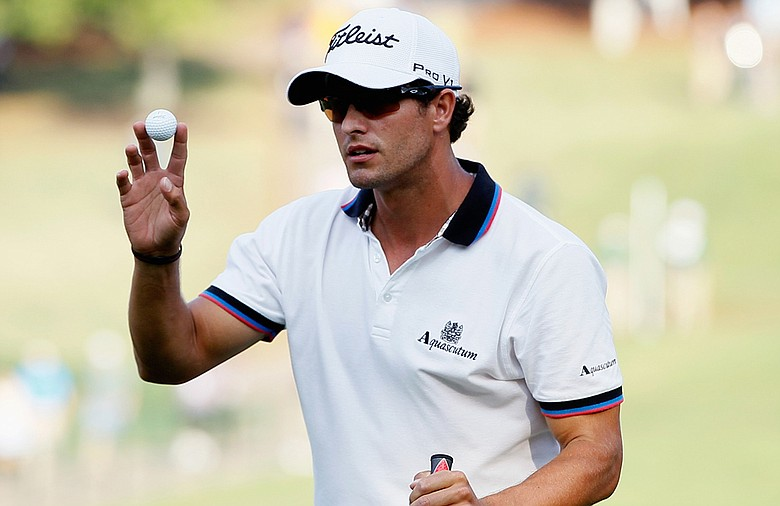 Adam Scott waves to the gallery after a birdie putt on the 18th green during the second round of the Tour Championship at East Lake Golf Club.