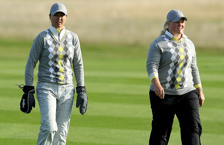 Caroline Hedwall and Sophie Gustafson, left, walk together during the morning foursomes on Day 2 of the 2011 Solheim Cup at Killeen Castle Golf Club.