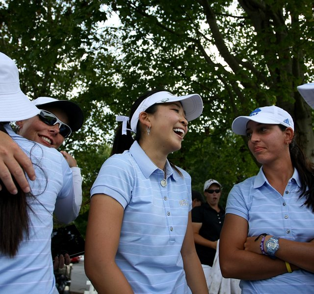 UCLA's Tiffany Lua, center, celebrates with her team after they won by 6 strokes at the Mason Rudolph Fall Preview.