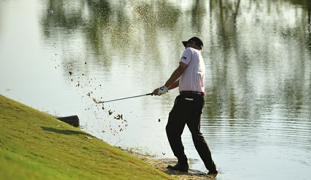 Bill Haas hits from the water on the 17th hole during a playoff against Hunter Mahan in the 2011 Tour Championship. Haas went on to win the Tour Championship and the $10 million FedEx Cup.