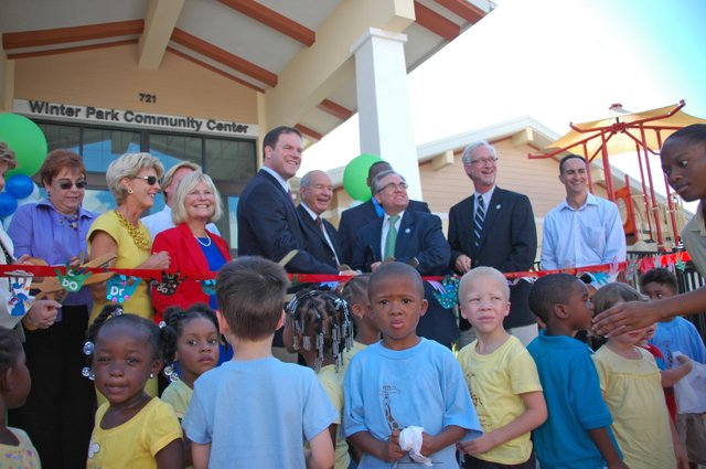 Commissioners, builders and city staff prepare to cut the ribbon for the Winter Park Community Center Sept. 23.