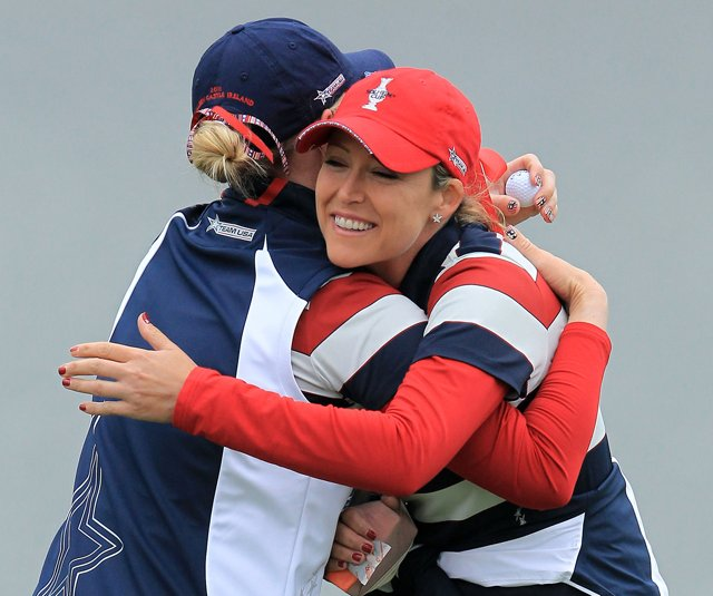 Cristie Kerr hugs Morgan Pressel after Pressel won her Solheim Cup singles match.