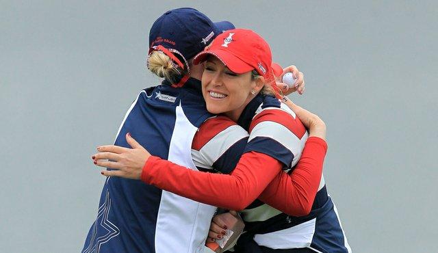 Cristie Kerr hugs Morgan Pressel after Pressel won her Solheim Cup singles match.