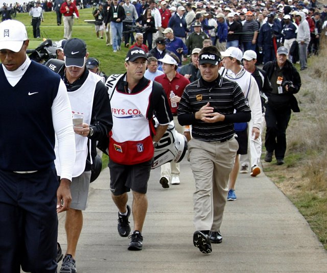 Tiger Woods leads the gallery down the fairway during the first round of the Frys.com Open.