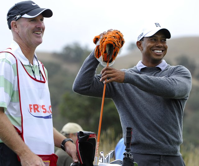 Tiger Woods smiles with his new caddie, Joe LaCava, during the pro-am prior to the Frys.com Open.