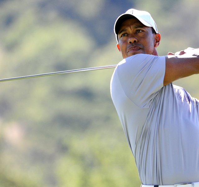 Tiger Woods makes a tee shot on the ninth hole during the second round of the Frys.com Open.