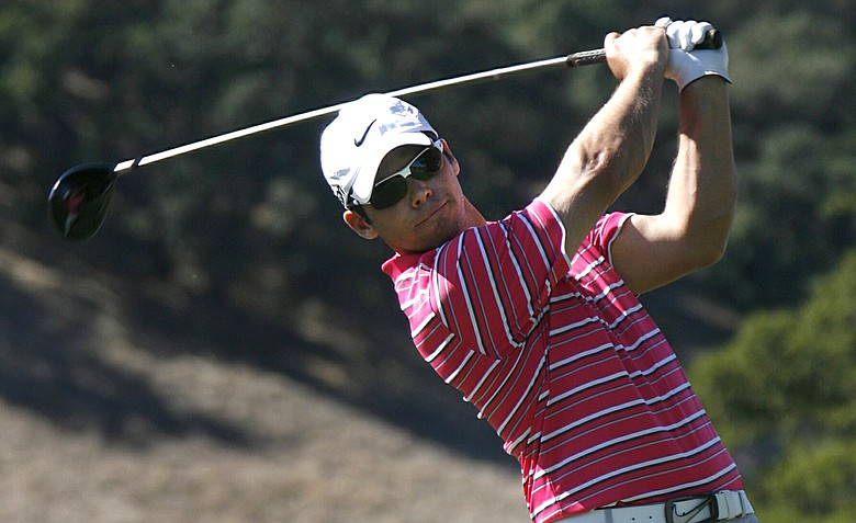 Paul Casey, of England, tees off on the ninth hole in the second round at the Frys.Com Open.