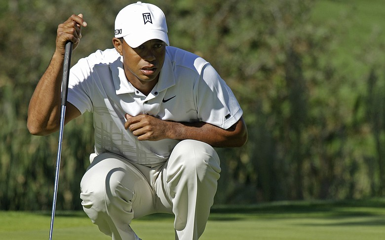 Tiger Woods lines up a putt during the third round of the Frys.com Open at CordeValle.