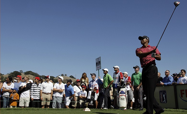Tiger Woods tees off on the second hole during the final round of the Frys.com Open.