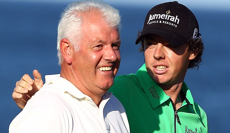 Rory McIlroy congratulates his father Gerry after holing a putt on the seventh green during the first round of The Alfred Dunhill Links Championship at the Kingsbarns Golf Links.