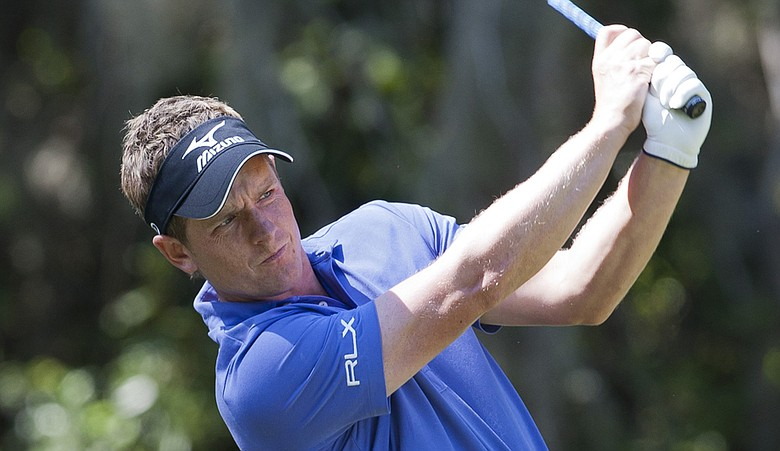 Luke Donald opened with a 66 at the Children's Miracle Network Classic and is part of a seven-way tie for the lead.