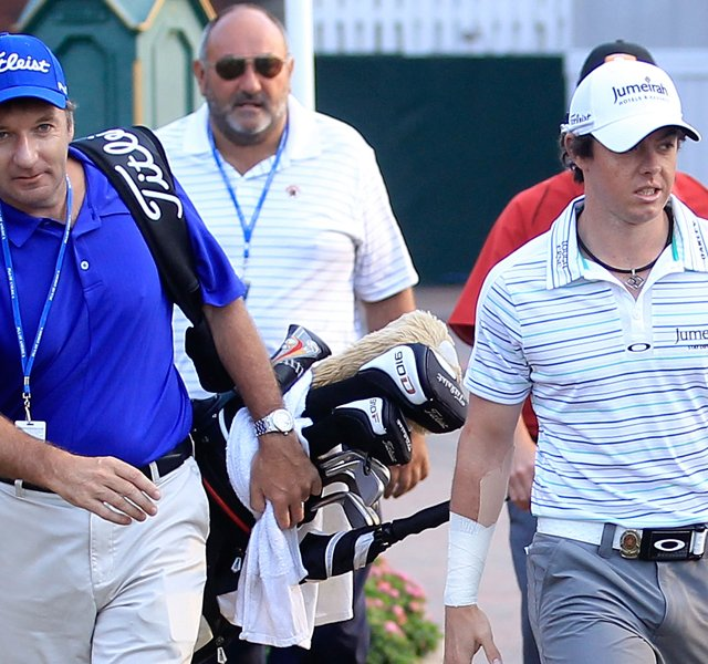 Rory McIlroy, right, is joined his caddie J.P. Fitzgerald, left, and his former manager Andrew &#39;Chubby&#39; Chandler. McIlroy announced he is leaving Chandler&#39;s ISM on Friday morning.