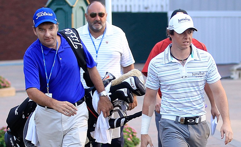 Rory McIlroy, right, is joined his caddie J.P. Fitzgerald, left, and his former manager Andrew 'Chubby' Chandler. McIlroy announced he is leaving Chandler's ISM on Friday morning.