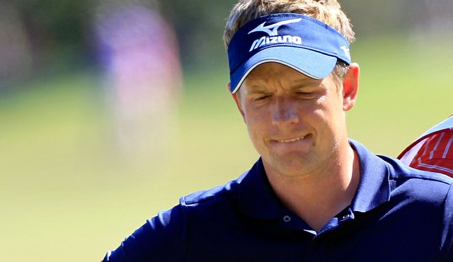 Luke Donald looks over a shot on the sixth hole during the second round of the Children's Miracle Network Classic.