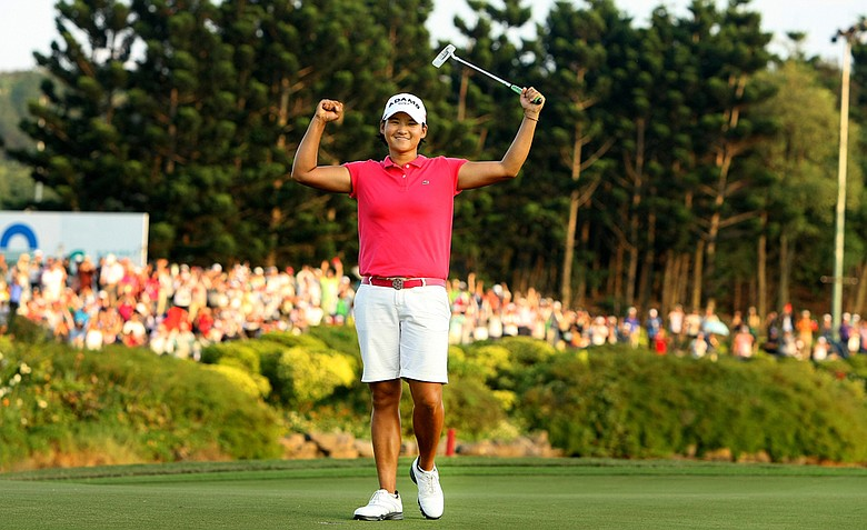 Yani Tseng raises her arms in victory after beating the field by five strokes to win the inaugural 2011 Sunrise LPGA Taiwan Championship.