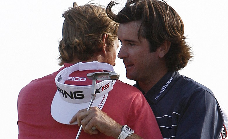 Bubba Watson, right, hugs Webb Simpson after winning the Zurich Classic golf tournament on the second playoff hole.