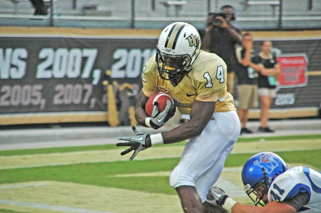 Quincy McDuffie carries the ball for one of UCF's five touchdowns against Memphis Oct. 29.