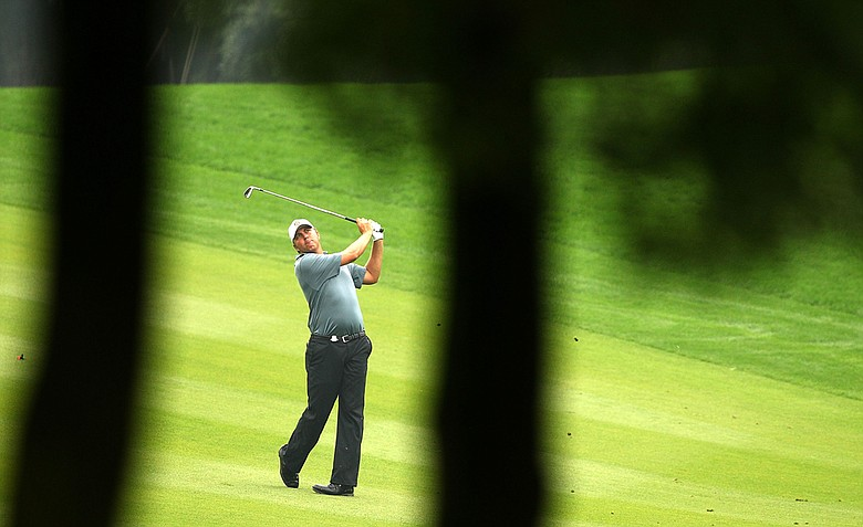 Bo Van Pelt watches his shot to the 15th green during the first round of the WGC-HSBC Champions.