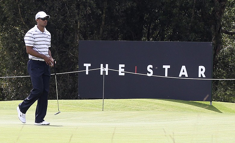 Tiger Woods walks on the 15th green during a pro-am event of the Australian Open.