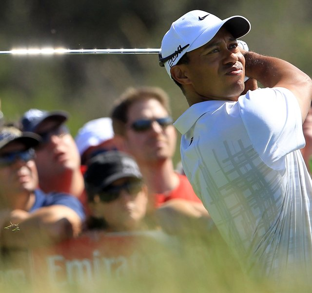 Tiger Woods hits his tee shot on the 18th hole during day two of the 2011 Australian Open.