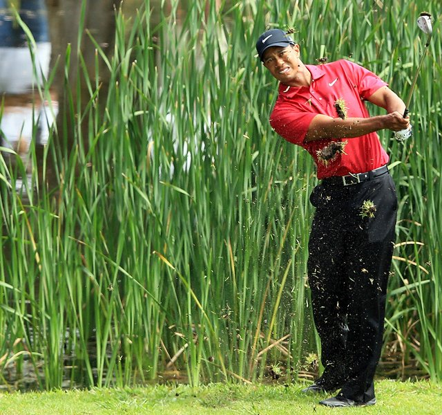 Tiger Woods follows his third shot on the par-4 13th hole during Day 4 of the Australian Open.