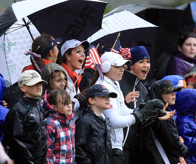 Members of the U.S. Junior Solheim Cup team cheer on teammates alongside local children at Knightsbrook Golf Resort and Spa.