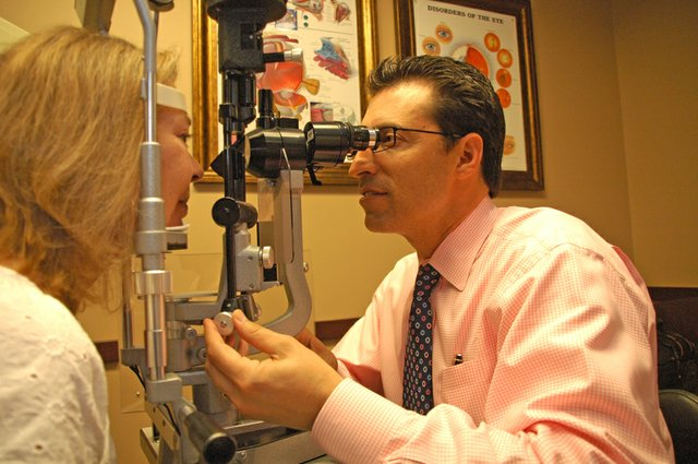 Dr. David Auerbach checks a cataract on patient Norma Smith, who received free surgery on Nov. 15.