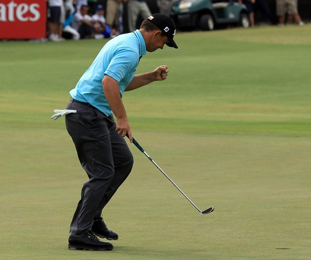Greg Chalmers follows a putt into the hole at the Australian Open.