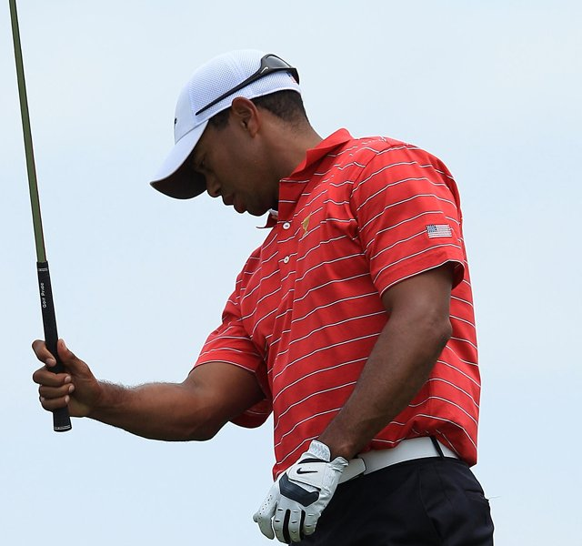 Tiger Woods of the U.S. team reacts to his second shot on the 10th hole during the Day Two Four-Ball matches of the 2011 Presidents Cup.