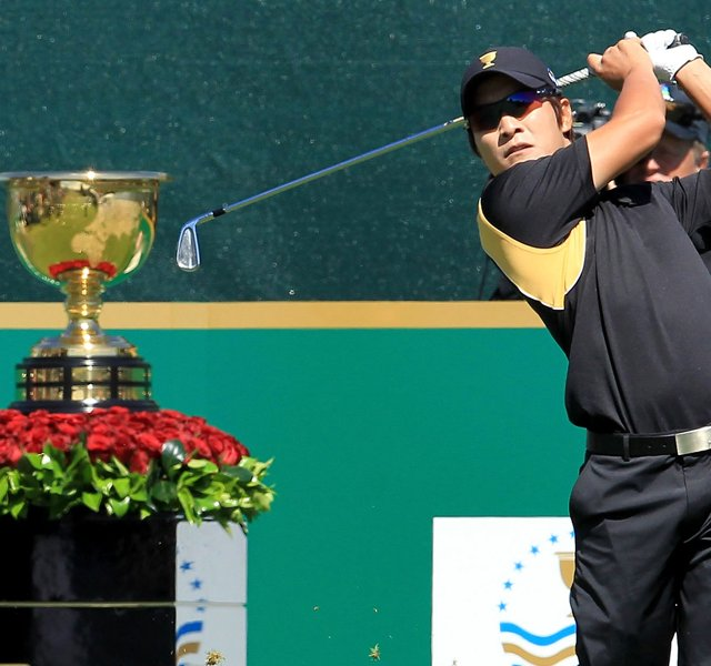 K.T. Kim of the International team plays his tee shot on the 1st hole during the Day Four singles matches of the 2011 Presidents Cup.
