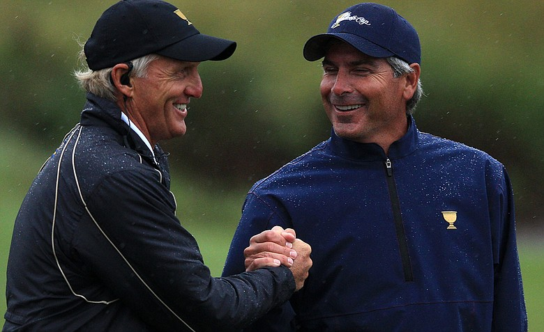 International captain Greg Norman shakes hands with U.S. captain Fred Couples after the Day Three afternoon four-ball matches at the 2011 Presidents Cup.